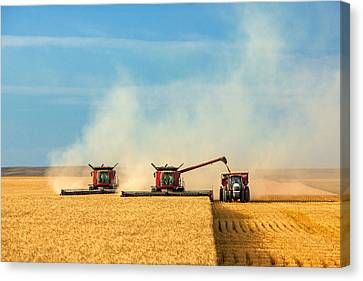 Combines And Tractor Working Together Canvas Print by Todd Klassy