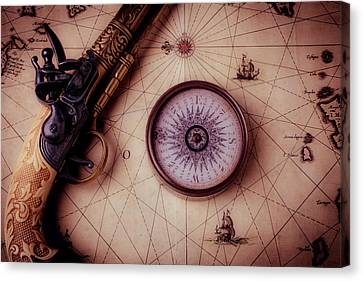 Compass And Pistole On Old Map Canvas Print by Garry Gay