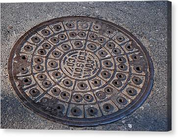 Con Ed Sewer Cap Canvas Print by Rob Hans