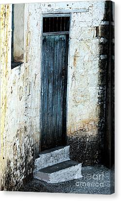 Corner Blue Door Canvas Print by John Rizzuto
