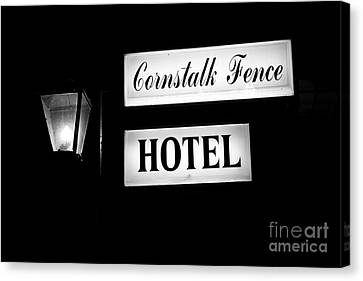 Cornstalk Fence Hotel Canvas Print by Leslie Leda