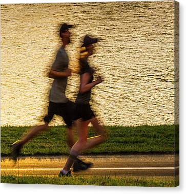 Couple Jogging In Forest Park Canvas Print by Garry McMichael