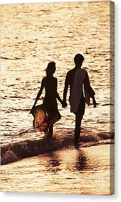 Couple Wading In Ocean Canvas Print by Larry Dale Gordon - Printscapes