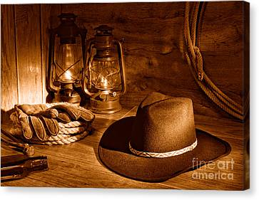 Cowboy Hat And Kerosene Lanterns - Sepia Canvas Print by Olivier Le Queinec