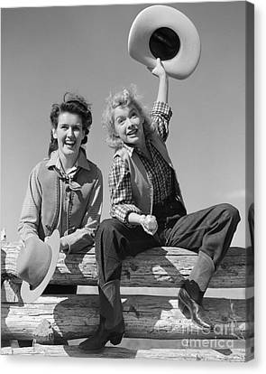 Cowgirls Sitting On A Fence, C.1940s Canvas Print by H. Armstrong Roberts/ClassicStock