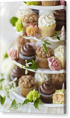 Cupcakes And Flowers On Tiered Stand Canvas Print by Gillham Studios