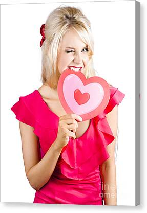 Cute Woman Biting Big Red Love Heart Canvas Print by Jorgo Photography - Wall Art Gallery