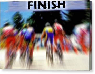 Cyclists Crossing The Finish Line Canvas Print by Steve Ohlsen