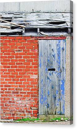 Damaged Roof Canvas Print by Tom Gowanlock