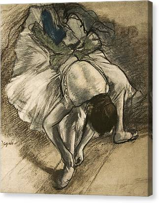 Dancer Tying Her Shoe Canvas Print by Edgar Degas