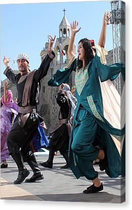 Dancing Near Nativity Church Canvas Print by Munir Alawi