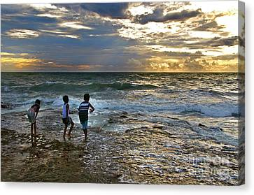 Dancing On The Beach Canvas Print by Charuhas Images