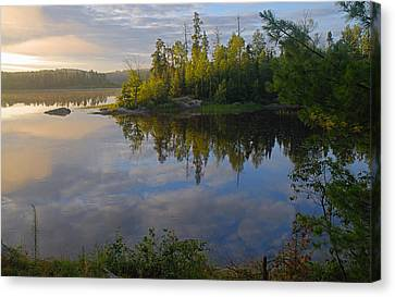 Dawn On The Basswood River Canvas Print by Larry Ricker