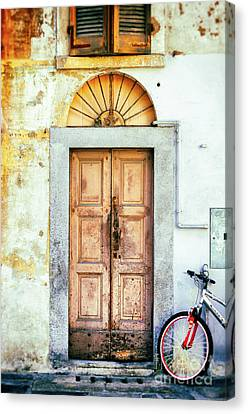 Decayed Door And Bicycle Canvas Print by Silvia Ganora