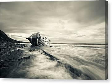 Defeated By The Sea Canvas Print by Inigo Barandiaran