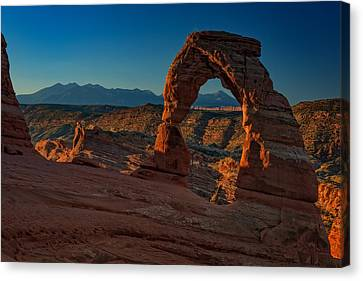 Delicate Arch At Sunrise Canvas Print by Rick Berk