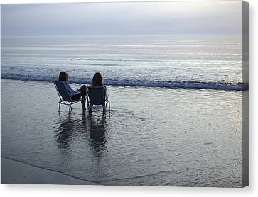 Denmark, Romo, Two Young Women Relaxing Canvas Print by Keenpress