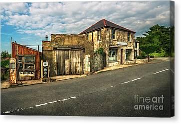 Derelict Old Garage Canvas Print by Adrian Evans