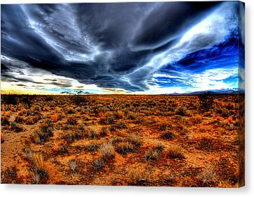 Desert Clouds Canvas Print by Tom Melo