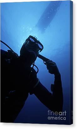 Diver Holding Gun To Head Underwater Canvas Print by Sami Sarkis