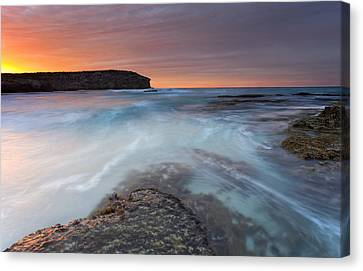 Divided Tides Canvas Print by Mike  Dawson