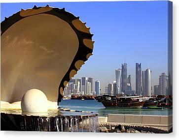 Doha Fountain Skyline And Harbour Canvas Print by Paul Cowan