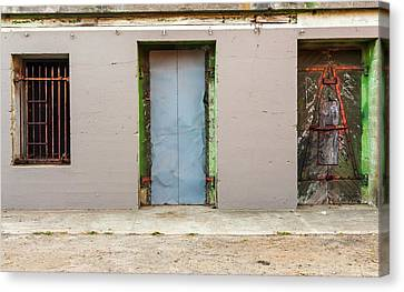 Doors And Bard Windows Canvas Print by Javier Flores