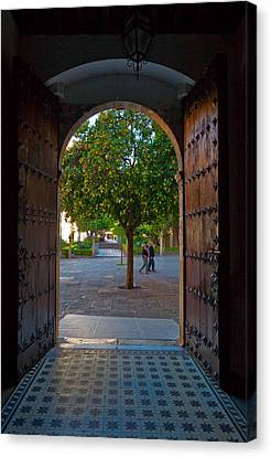 Doorway And Arch Between Gardens Canvas Print by Panoramic Images