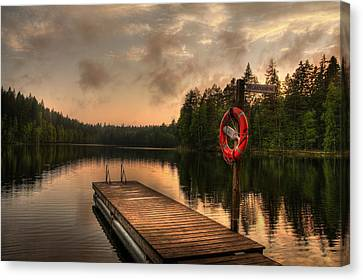 Dramatic Sunset On A Lake In Finland Canvas Print by Sandra Rugina