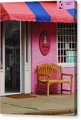 Dress Shop With Orange And Blue Awning Canvas Print by Susan Savad