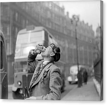 Drinking Beer Canvas Print by John Drysdale
