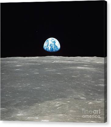 Earth And The Moon Canvas Print by Stocktrek Images