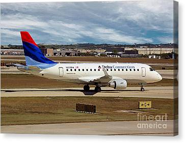Embraer Erj-170-100se Shuttle America And Delta Connection In San Antonio Canvas Print by Wernher Krutein