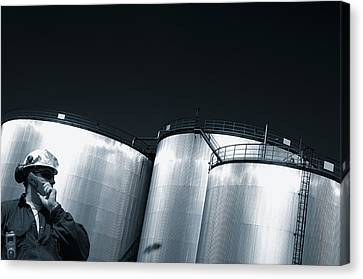 Engineer And Oil Towers At Sunset Canvas Print by Christian Lagereek