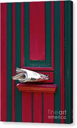 Entrance Door And Newspaper Canvas Print by Heiko Koehrer-Wagner