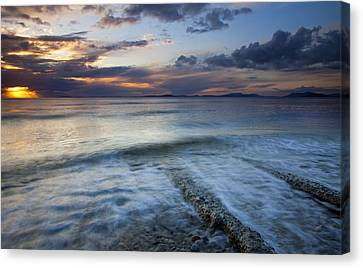 Eroded By The Tides Canvas Print by Mike  Dawson
