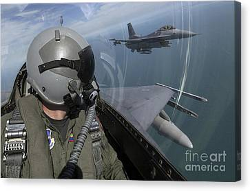 F-16 Fighting Falcons Flying Canvas Print by Stocktrek Images