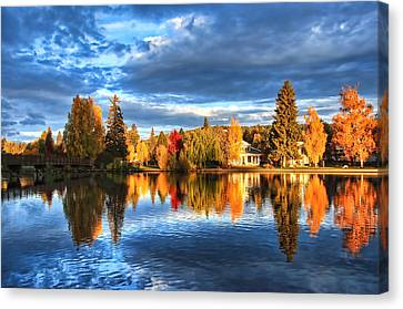Fall Colors On Mirror Pond Canvas Print by John Melton
