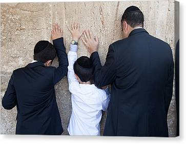 Father And Son Pray To G-d At The Wailing Wall Canvas Print by Yoel Koskas