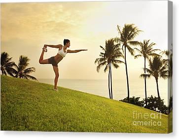 Female Doing Yoga Canvas Print by Brandon Tabiolo - Printscapes