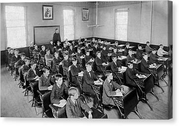 Fifty Boys In A Classroom Canvas Print by Underwood Archives