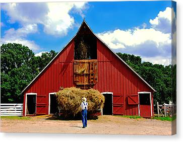 Filling The Haymow Canvas Print by Lyle  Huisken