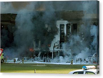 Firefighters Work To Put Out The Flames Canvas Print by Everett