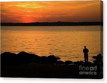 Fishing At Sunset Canvas Print by Karol Livote