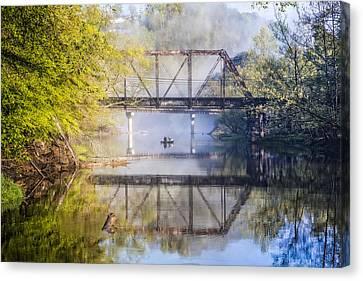 Fishing Under The Trestle Canvas Print by Debra and Dave Vanderlaan