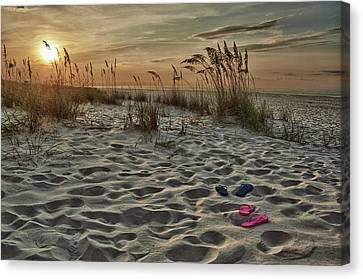 Flipflops On The Beach Canvas Print by Michael Thomas