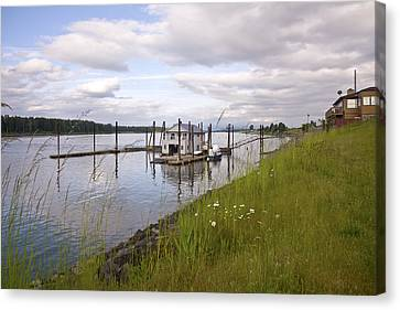 Floating House On The Columbia River Oregon. Canvas Print by Gino Rigucci