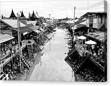 Floating Market In Thailand Canvas Print by Sarayut Mathavetchathum