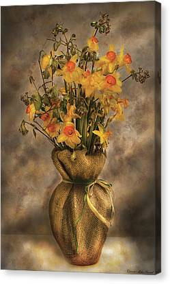 Flower - Daffodils In A Burlap Vase Canvas Print by Mike Savad