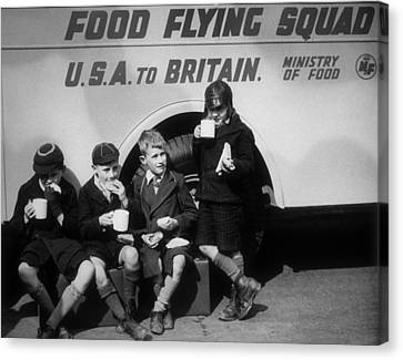 Food Flying Squad Canvas Print by Fox Photos